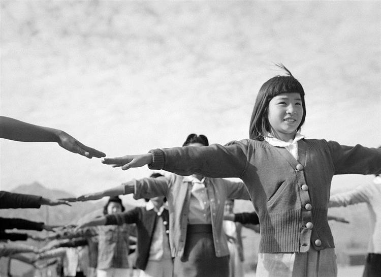 Female interns practicing calisthenics at Manzanar internment camp - Ansel Adams